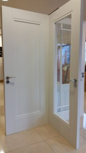 Primed solid internal doors at our Tramore showrooms.